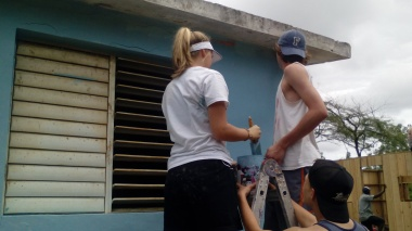 Young people paint the pastoral house